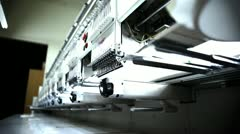 Under Row of Embroidery Machines Stock Footage