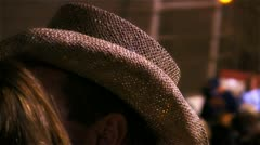 Stock Video Footage of Straw cowboy hat on spectator at night