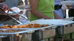 People getting food at Hawaiian Luau Stock Footage