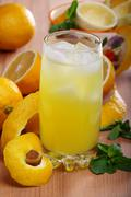 Lemonade from fresh lemons, ice and mint in a vertical format. Stock Photos
