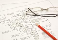 Draftings, pencil and glasses Stock Photos