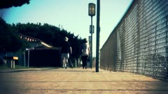 Low angle shot of couple strolling along boardwalk - stock footage