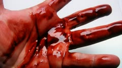 Bloody hand over white surface Stock Footage