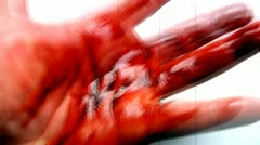 Fast and Jittery footage of bloody hand with grain - stock footage
