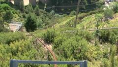 Rack-rail cart down a steep hillside Stock Footage