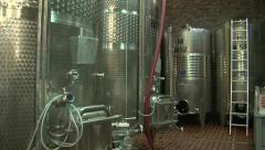 Stainless steel wine distilling vats - stock footage