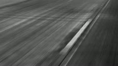 Tire marks on highyway in black and white Stock Footage