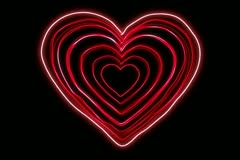 Glowing Neon Heart shapes echoed line art sequence on Black Stock Footage