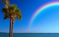 rainbow over ocean - stock photo