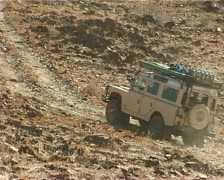 4x4 Landrovers driving on off road track in Damaraland, Namibia. Stock Footage