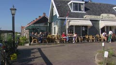 Harbor Cafe Isle of Marken, pan quay harbor and boats Stock Footage