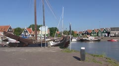 Harbour Isle of Marken pan quay traditional green painted wooden houses Stock Footage
