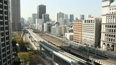 Trains travel through the Tokyo district of Shiodome Stock Footage