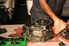 Mechanic takes apart transmission - stock footage
