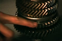 Gears and parts of transmission torn apart gets inspected Stock Footage