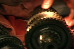 Mechanic inspects gears of a transmission - stock footage