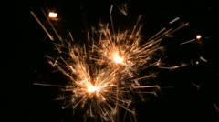 Two sparklers in hand Stock Footage