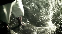Vanishing footprints in the sand on beach Stock Footage