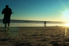 Activities at the Beach during sunset - stock footage