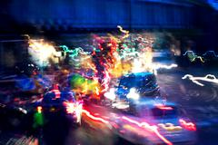 traffic rush on london street by night - stock photo