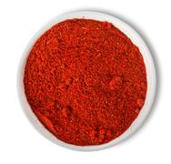 Ground paprika in plate isolated Stock Photos