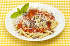 traditional macaroni pasta with tomato grated cheese - stock photo