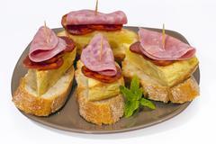 spanish omelette with chorizo iberico - stock photo