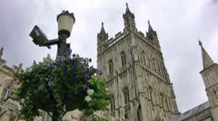 Gloucester cathedral and hanging flower basket Stock Footage