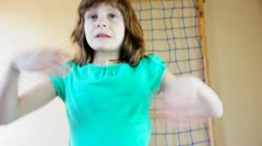 Child  exercising on gymnastic rings Stock Footage