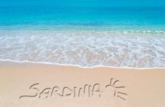 Turquoise foreshore with sardinia writing Stock Photos