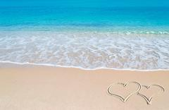 Turquoise foreshore and hearts Stock Photos