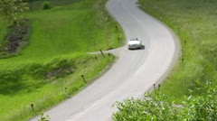 Driving Jaguar car on curving road on sunny days - stock footage