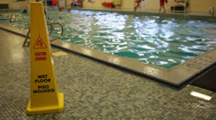 Caution Wet Floor Sign on Deck of Indoor Swimming Stock Video Stock Footage