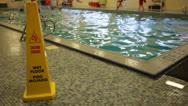 Caution Wet Floor Sign on Deck of Indoor Swimming Stock Video Stock Footage