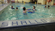 Shallow Water Sign in an Indoor Pool Stock Video Stock Footage