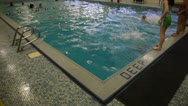 Kids Jump in Deep End of Indoor Swimming Pool Stock Video Stock Footage