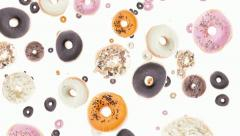 Donuts falling down (ends on green) Stock Footage