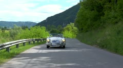 A Man Catches a Ride on a Classic Car Stock Footage