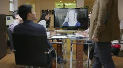Young professional business team in a meeting via video call Stock Footage