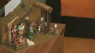 Stock Video Footage of A little girl decorating a Christmas manger