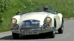 Vintage Classic Convertible Jaguar travels through Europe on Sunny Day Stock Footage