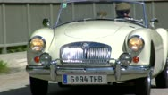 Stock Video Footage of Vintage Classic Car Convertible Jaguar Driving through European roadside