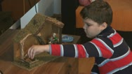 Stock Video Footage of Child.Boy decorating a Christmas manger.