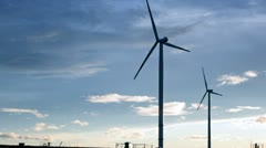 Green renewable energy concept - wind generator turbines in sky Stock Footage