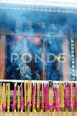 Stock photo of burning incense sticks