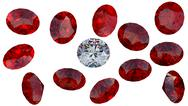 Stock Illustration of large diamond among red rubies