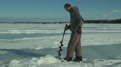 Man drill ice fishing hole Stock Footage