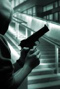 Stock Photo of boy with a gun at street at night