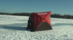 Setting up ice fishing tent Stock Footage