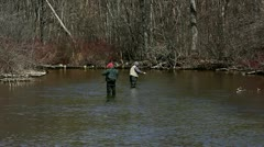 Men flyfishing for rainbow trout Stock Footage